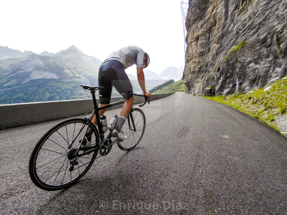 """Cyclist mid climb in the French Pyrenees"" stock image"