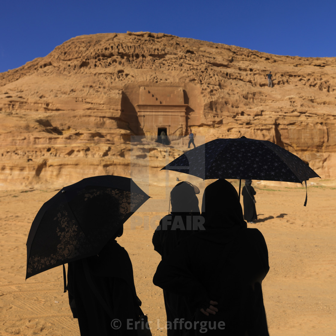 """Tourists in madain saleh archaeologic site, Saudi arabia"" stock image"