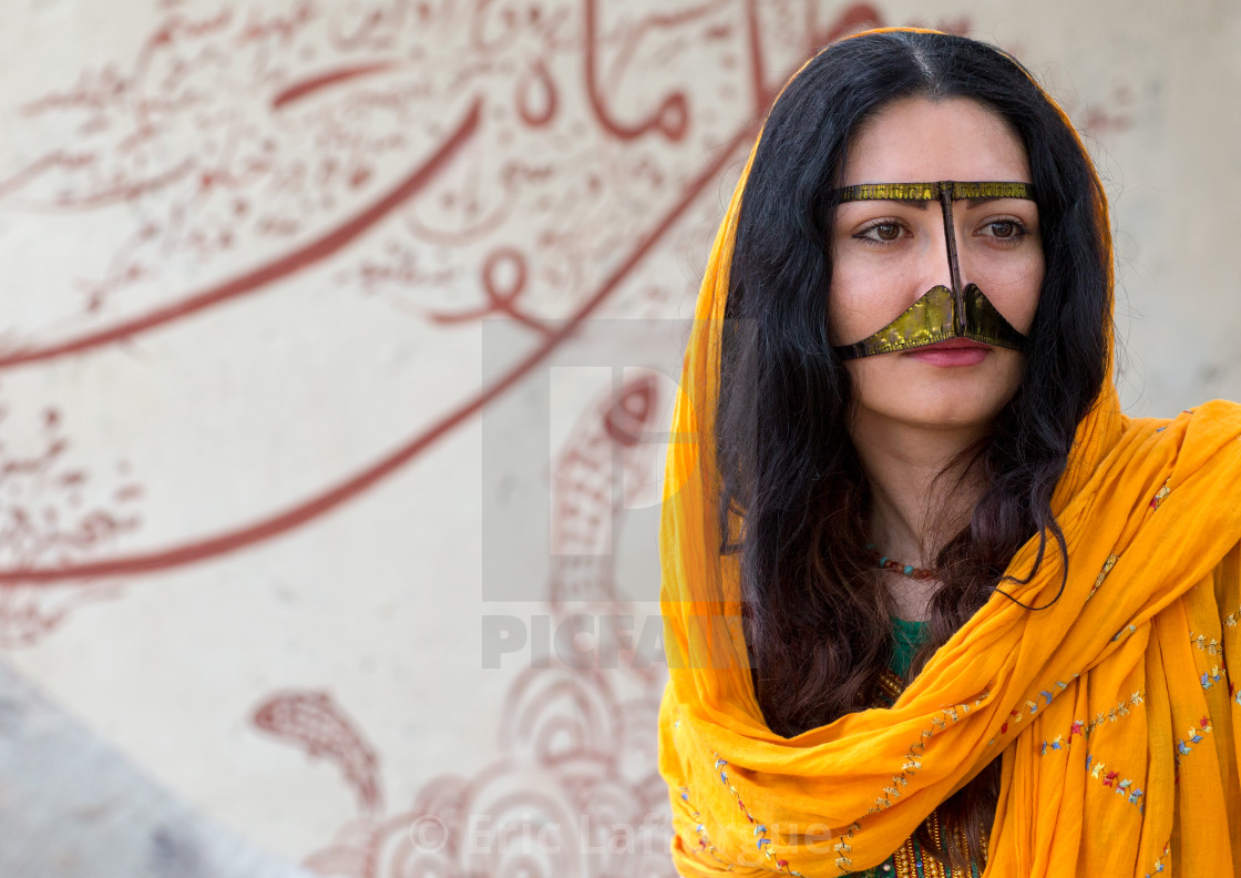 """a bandari woman wearing a traditional mask called the burqa with a moustache..."" stock image"