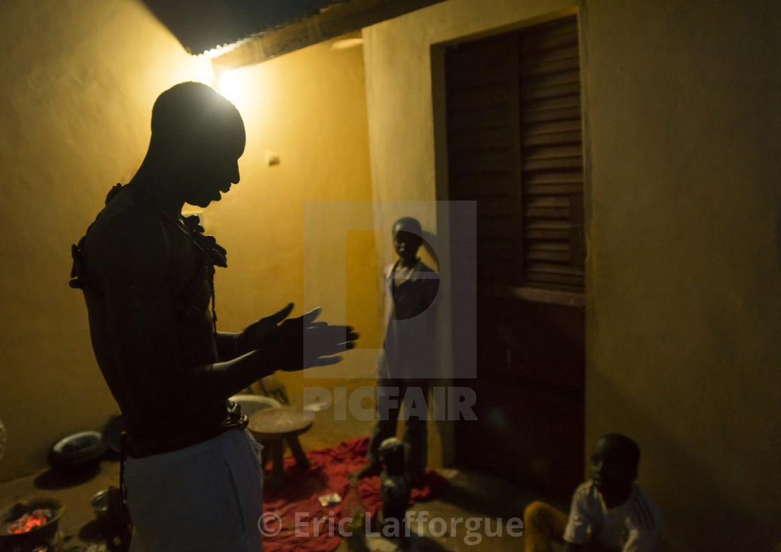 Benin, West Africa, Bonhicon, kagbanon bebe voodoo priest praying in