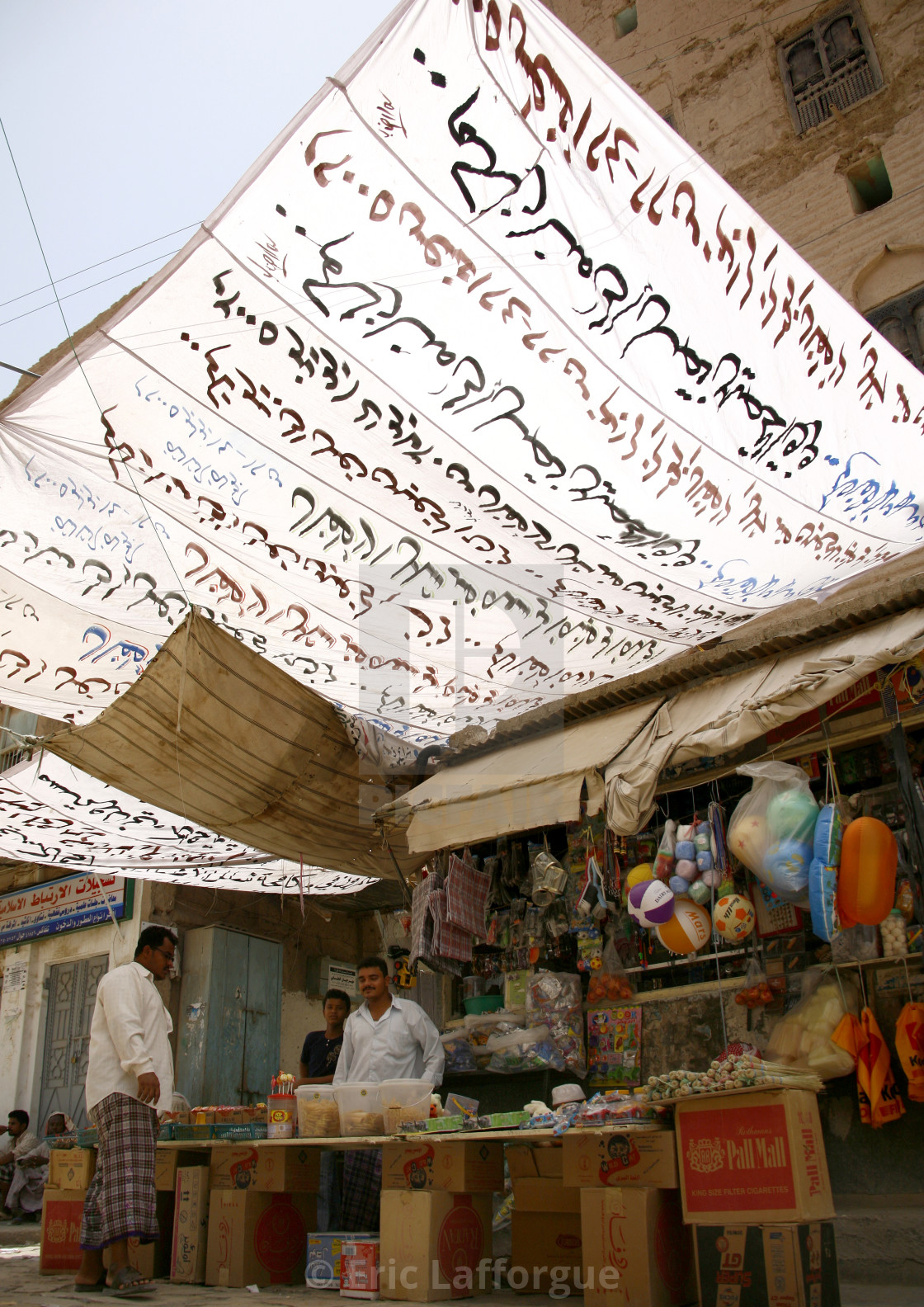 """Small Shop Under A White Awning With Arabic Writing, Tarim Market, Yemen"" stock image"