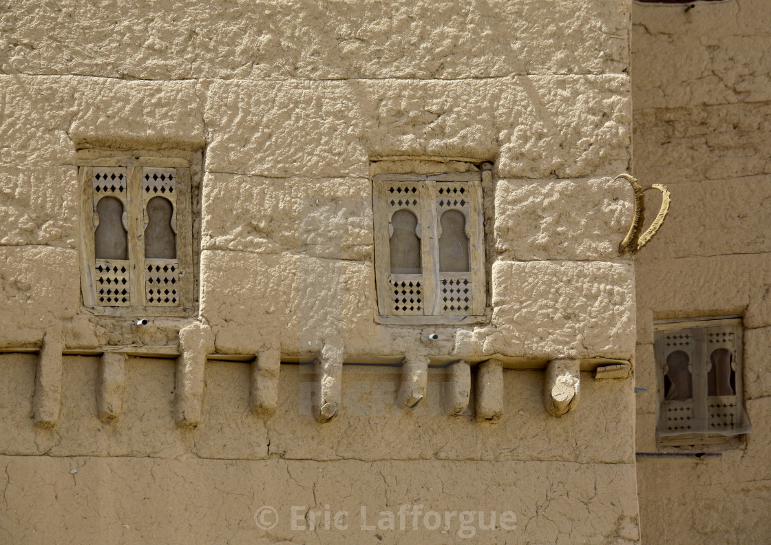 """Wooden Windows On A Adobe And Painted Building Wadi Doan, Yemen"" stock image"