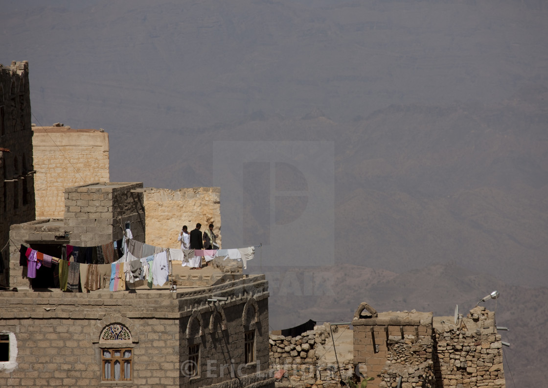 """Clothes Hung To Dry On A Roof, Kholan Village, Yemen"" stock image"