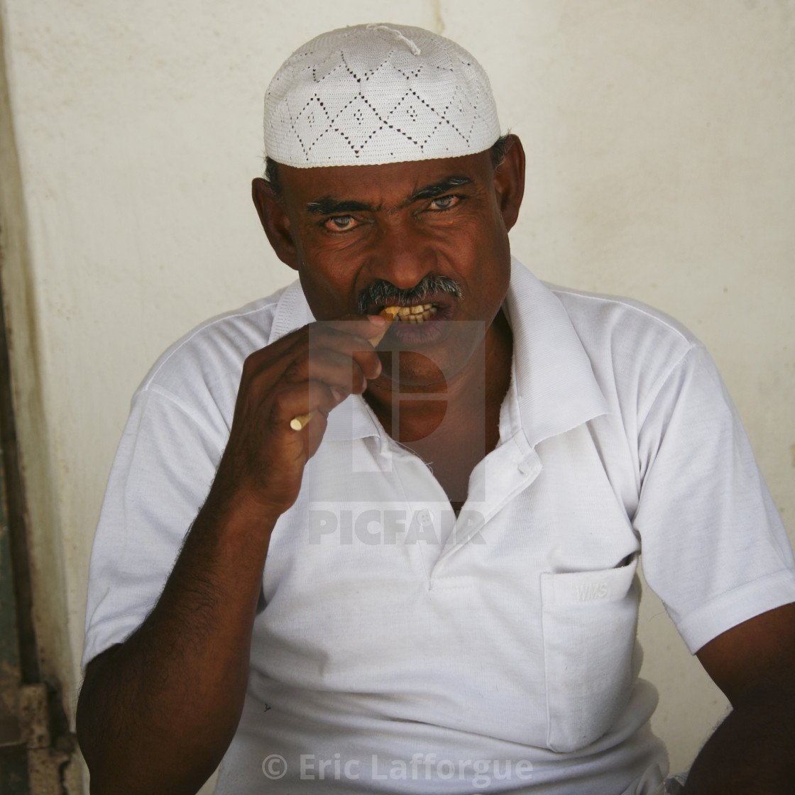 """Yemenni Man With White Taqiyah Chewing A Toothbrush Stick, Tarim, Yemen"" stock image"
