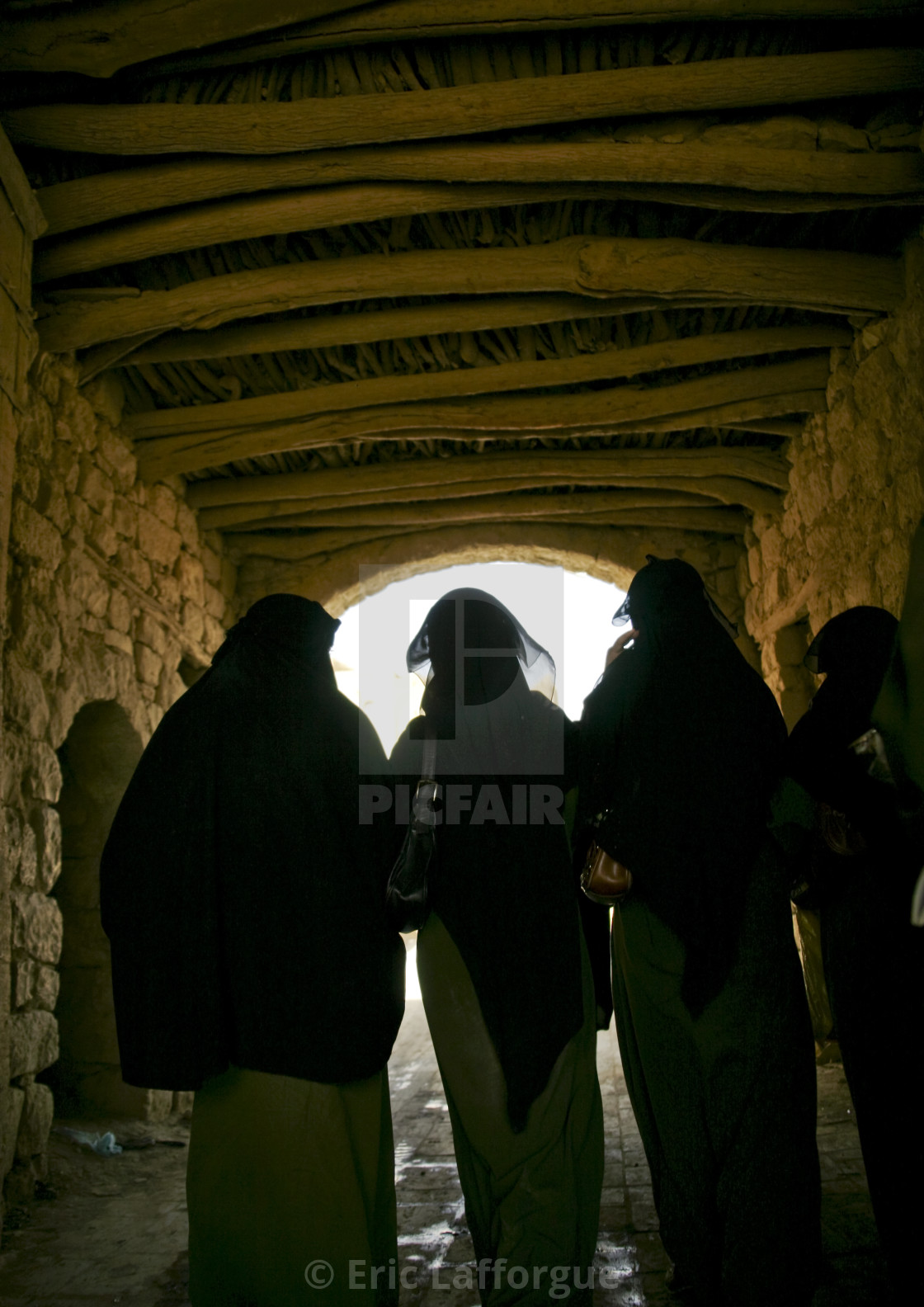 """Veiled Women In A Covered Back Alley, Amran, Yemen"" stock image"