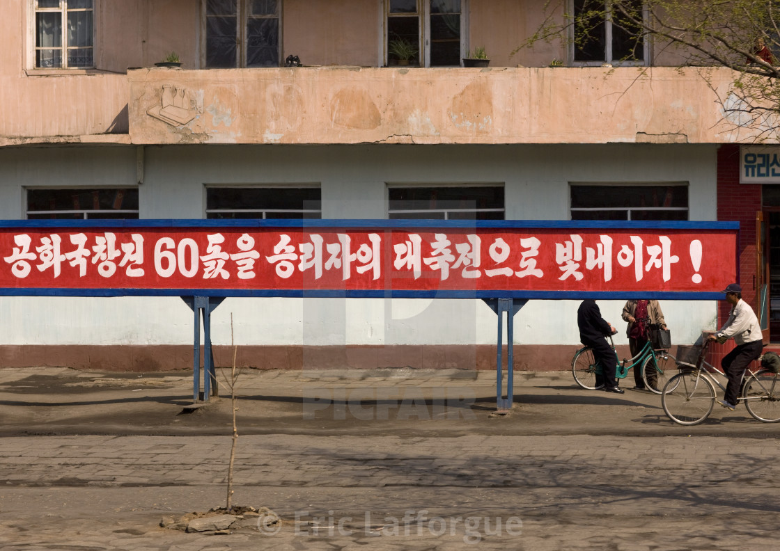 """Propaganda slogan on a red billboard in town, South Pyongan Province, Nampo,..."" stock image"