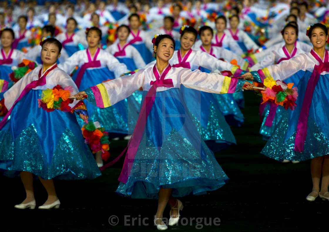 """North Korean women dancing in choson-ot during the Arirang mass games in may..."" stock image"
