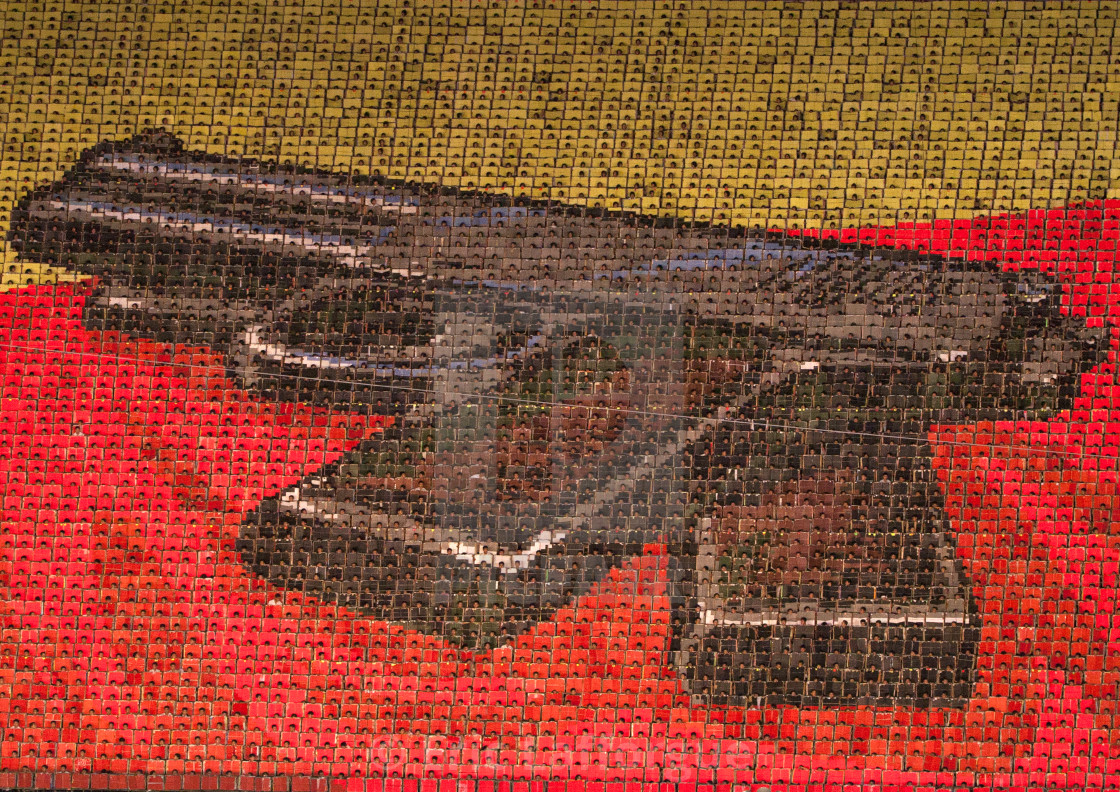 """Kim il Sung pistol made by children pixels holding up colored boards during..."" stock image"