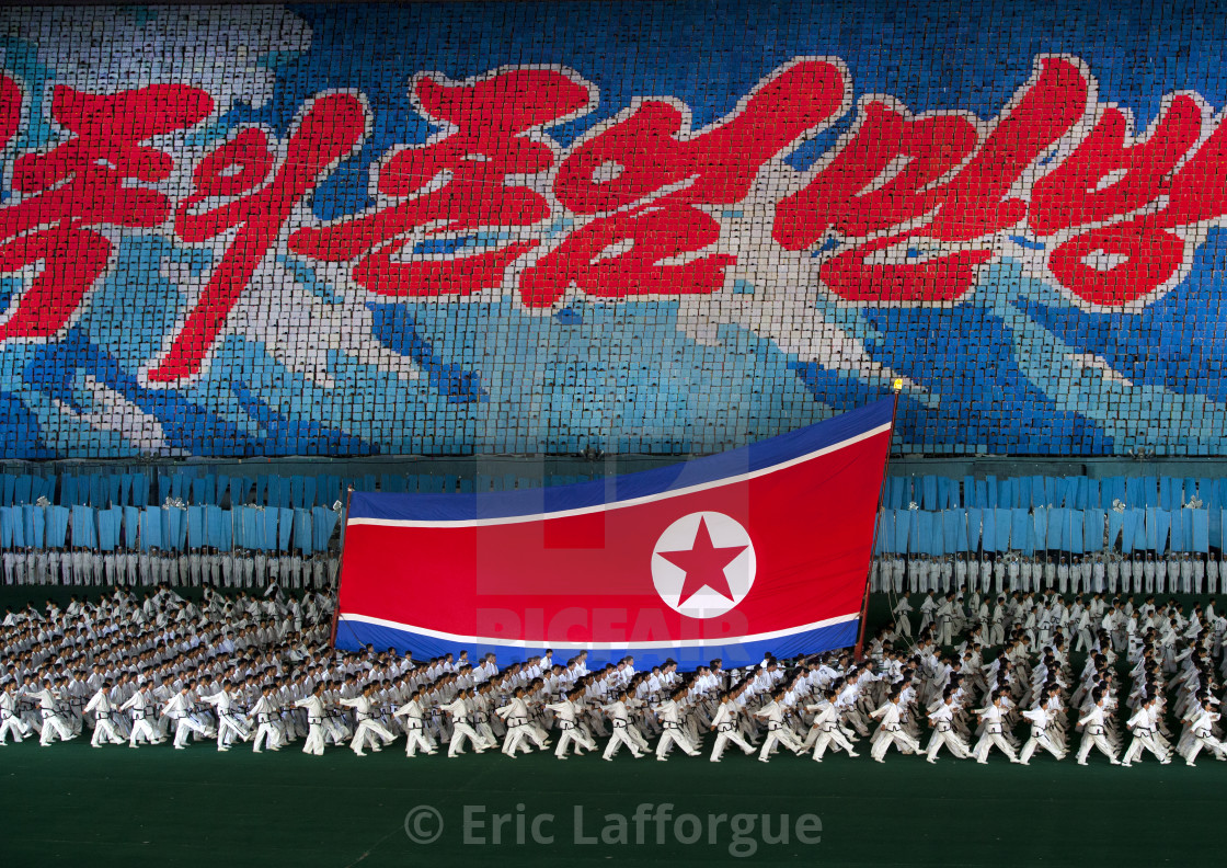 """North Korean taekwondo team in front of a giant flag during the Arirang mass..."" stock image"