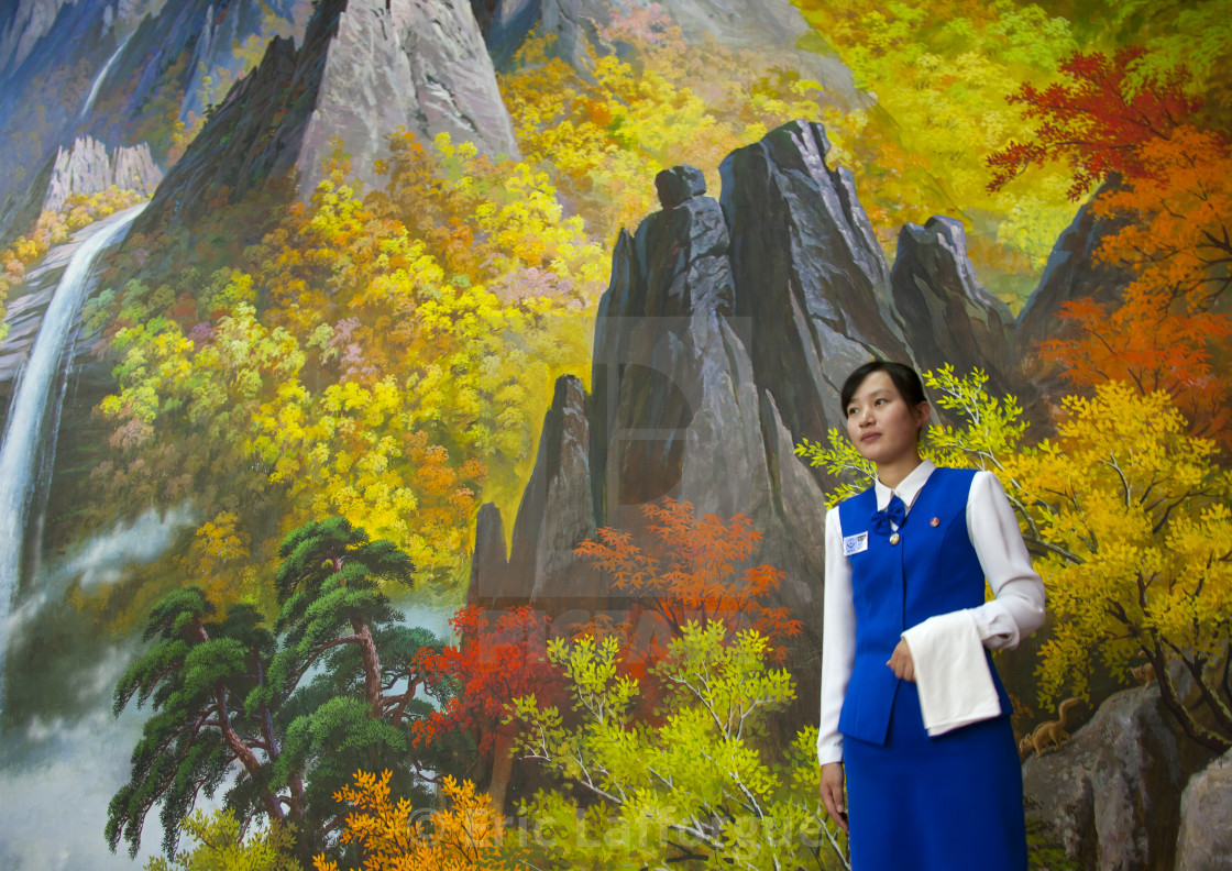 """North Korean waitress in front of nature painting in a restaurant, South..."" stock image"
