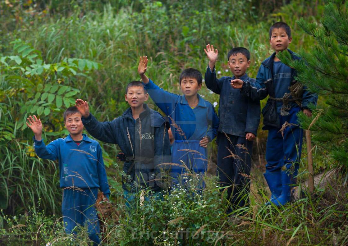 """""""North Korean group of children waving hands in the countryside, North..."""" stock image"""
