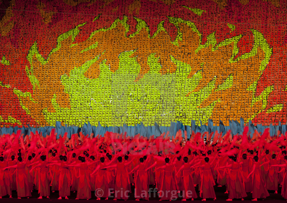 """North Korean dancers in front of a sky of fire made by children pixels..."" stock image"