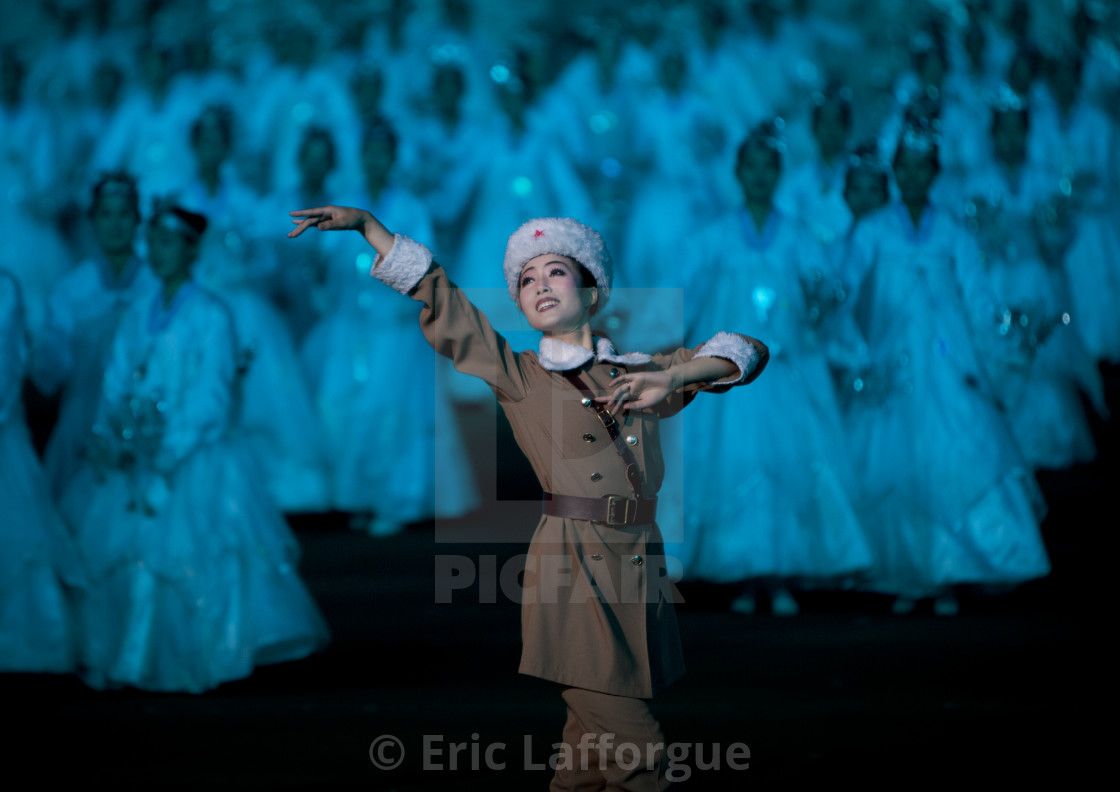 """North Korean woman dressed as soldier during the Arirang mass games at may..."" stock image"