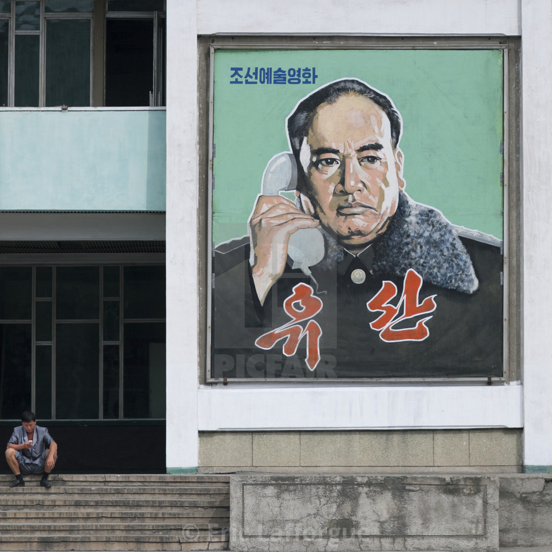 """North Korean military man on the phone on a movie poster, Pyongan Province,..."" stock image"