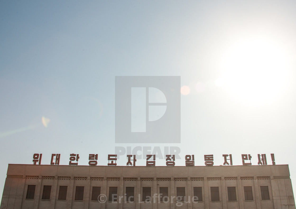 """""""Roof of a building with propaganda slogan on the top, North Hamgyong..."""" stock image"""