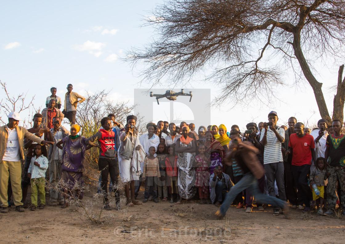 Borana people watching a mavic pro dji drone during the Gada