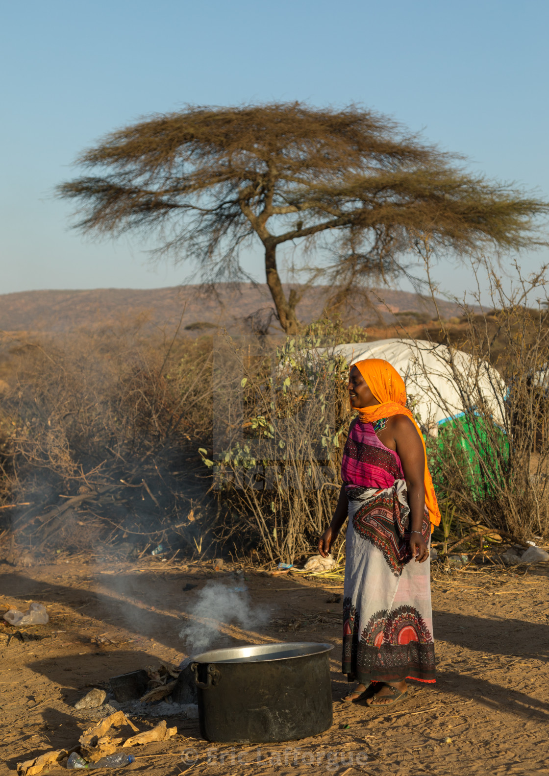 Woman cooking during the Gada system ceremony in Borana tribe