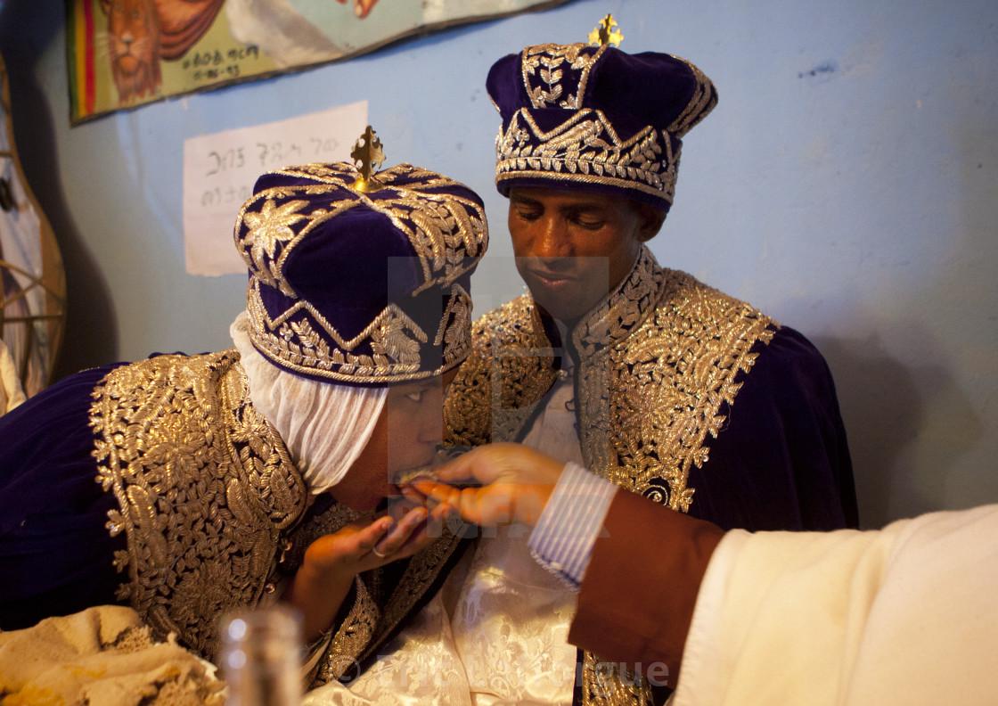 Priest Feeding Newlyweds During An Ethiopian Wedding In An Orthodox