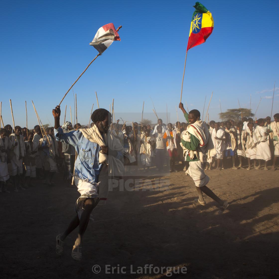 Karrayyu Tribe Men Carrying The Oromo And Ethiopian Flag