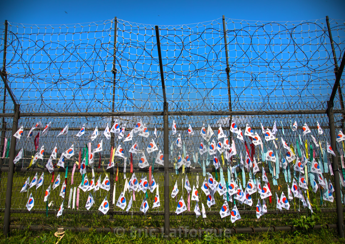 Messages of peace and unity written on ribbons left on fence at DMZ