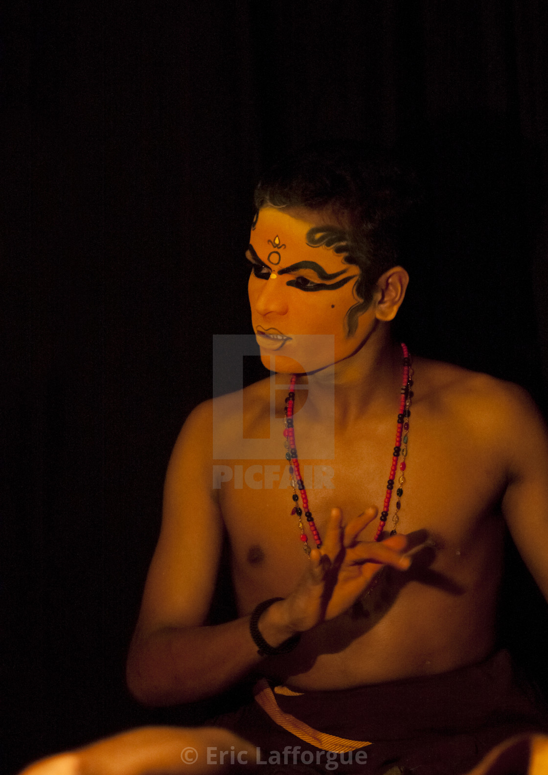 """Kathakali Dancer With Traditional Face Make Up Preparing Himself For The..."" stock image"