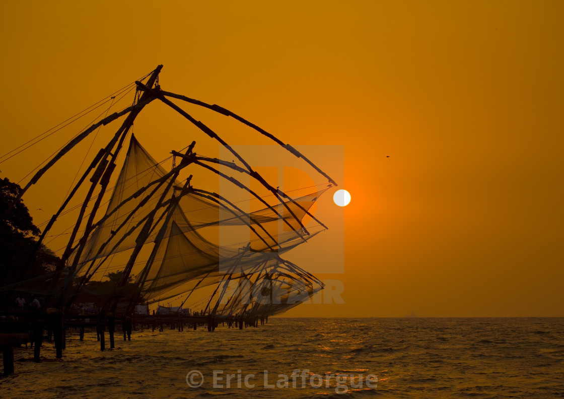 """Chinese Fishing Nets In Silhouette At Sunset, Kochi, India"" stock image"