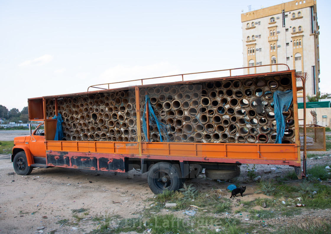 Old truck carrying beehives to collect honey, Mecca province