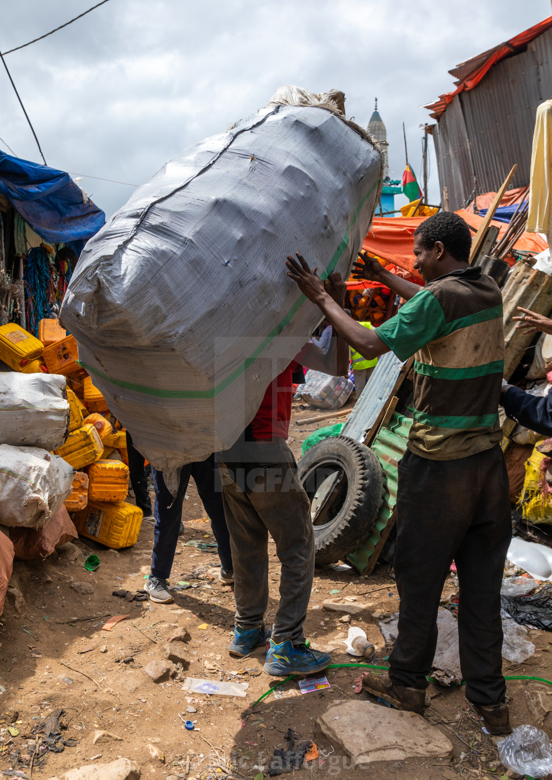 Ethiopian Man Carrying A Huge Bag In The Metal Market In The Old Town Harari License Download Or Print For 57 70 Photos Picfair
