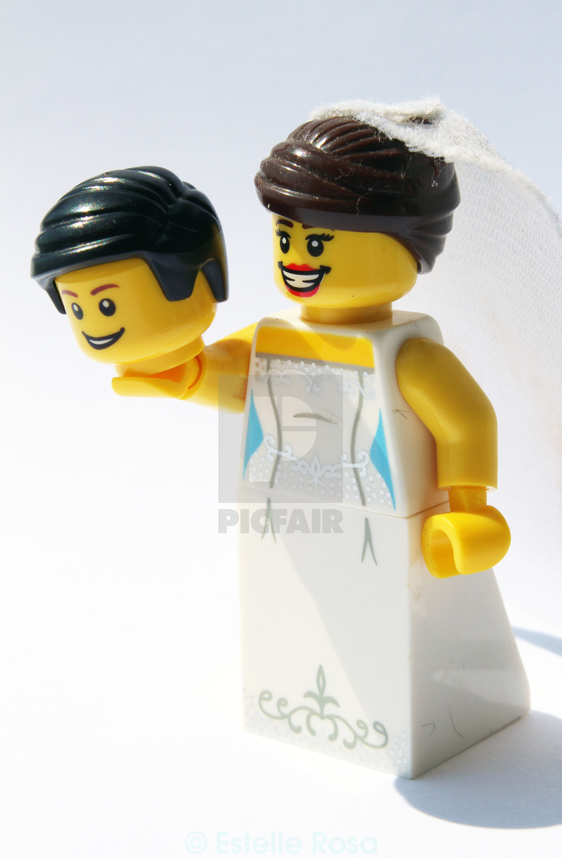 """Lego bride holding head"" stock image"