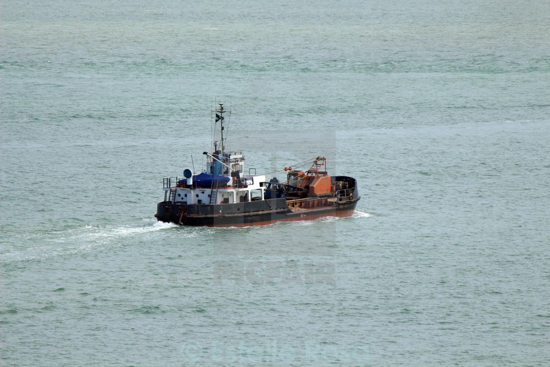 """Dredger at sea"" stock image"