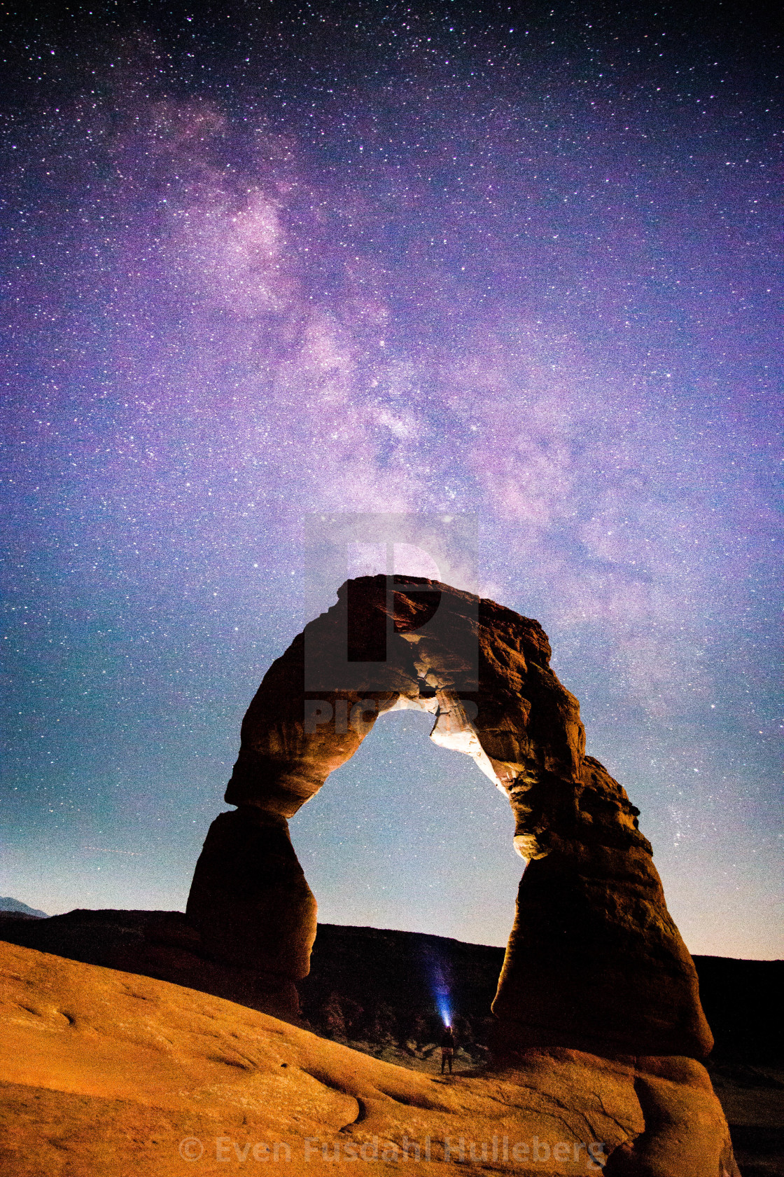 """People in nature, watching the Milky Way above Delicate Arch, Arches National Park, Utah"" stock image"