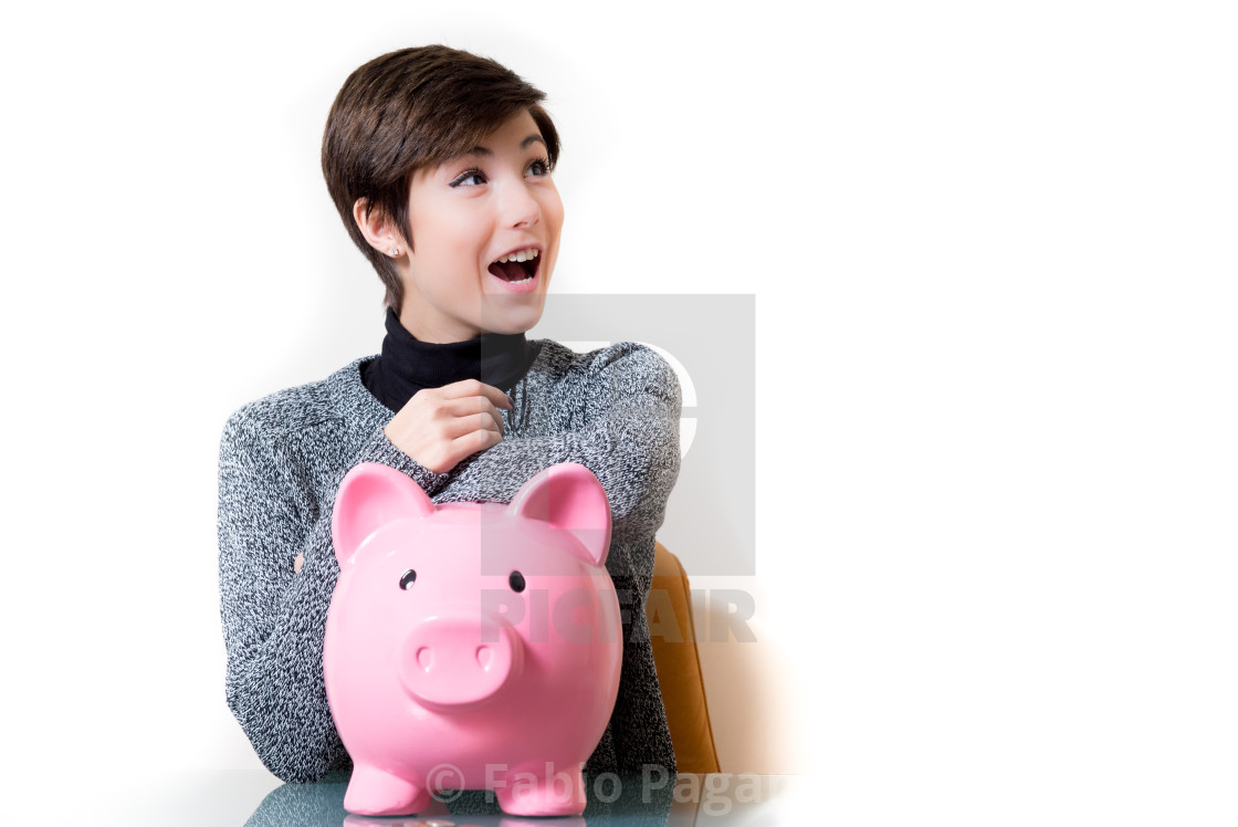 """Happy about savings on a piggy bank"" stock image"