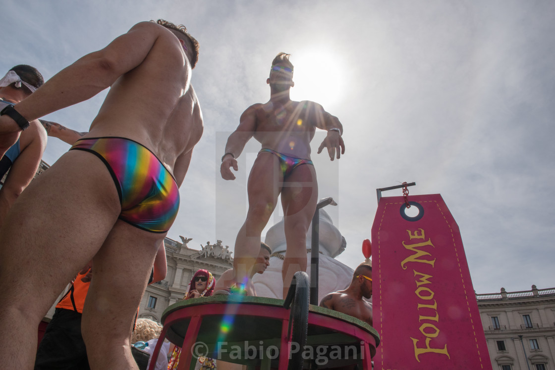 """Gay pride day in Rome. People dancing on a float during parade"" stock image"