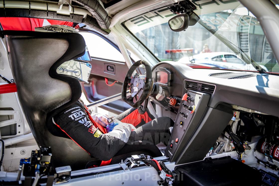 Porsche Carrera racing car driver in cockpit , License
