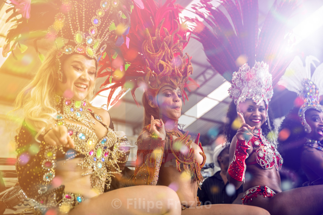"""Brazilian women dancing samba music at carnival party"" stock image"