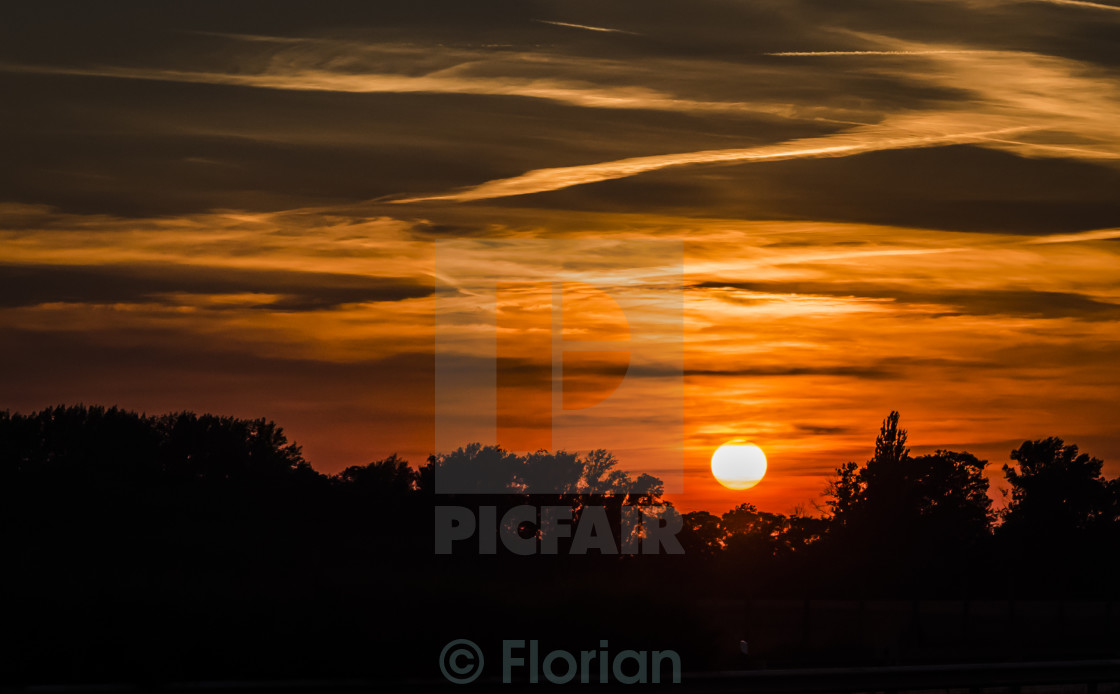 """Sunset with silhouette"" stock image"