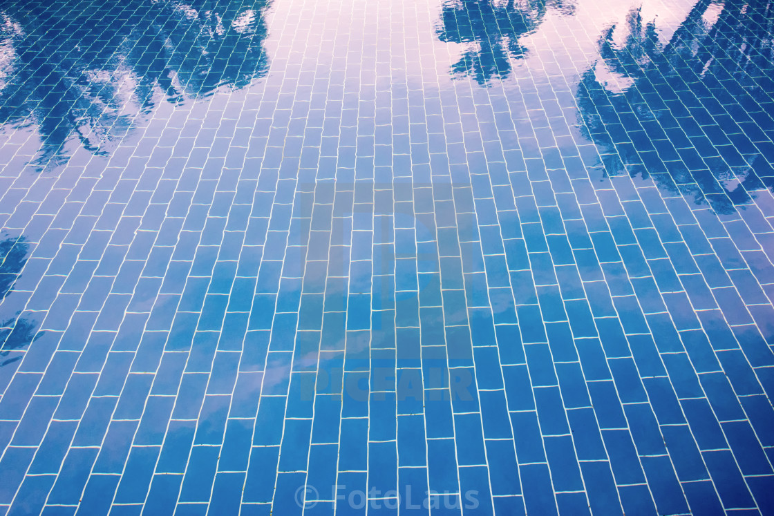 """Blue tiled floor of a pool under clear water"" stock image"