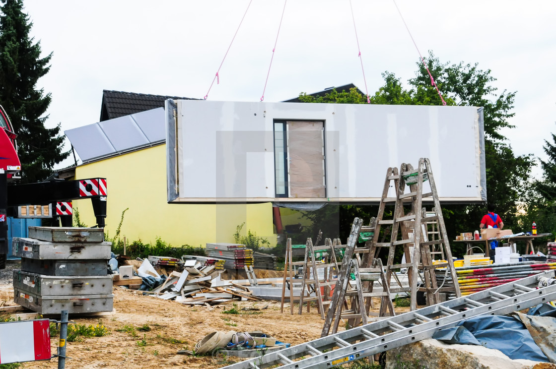 """Assembly of prefabricated house"" stock image"