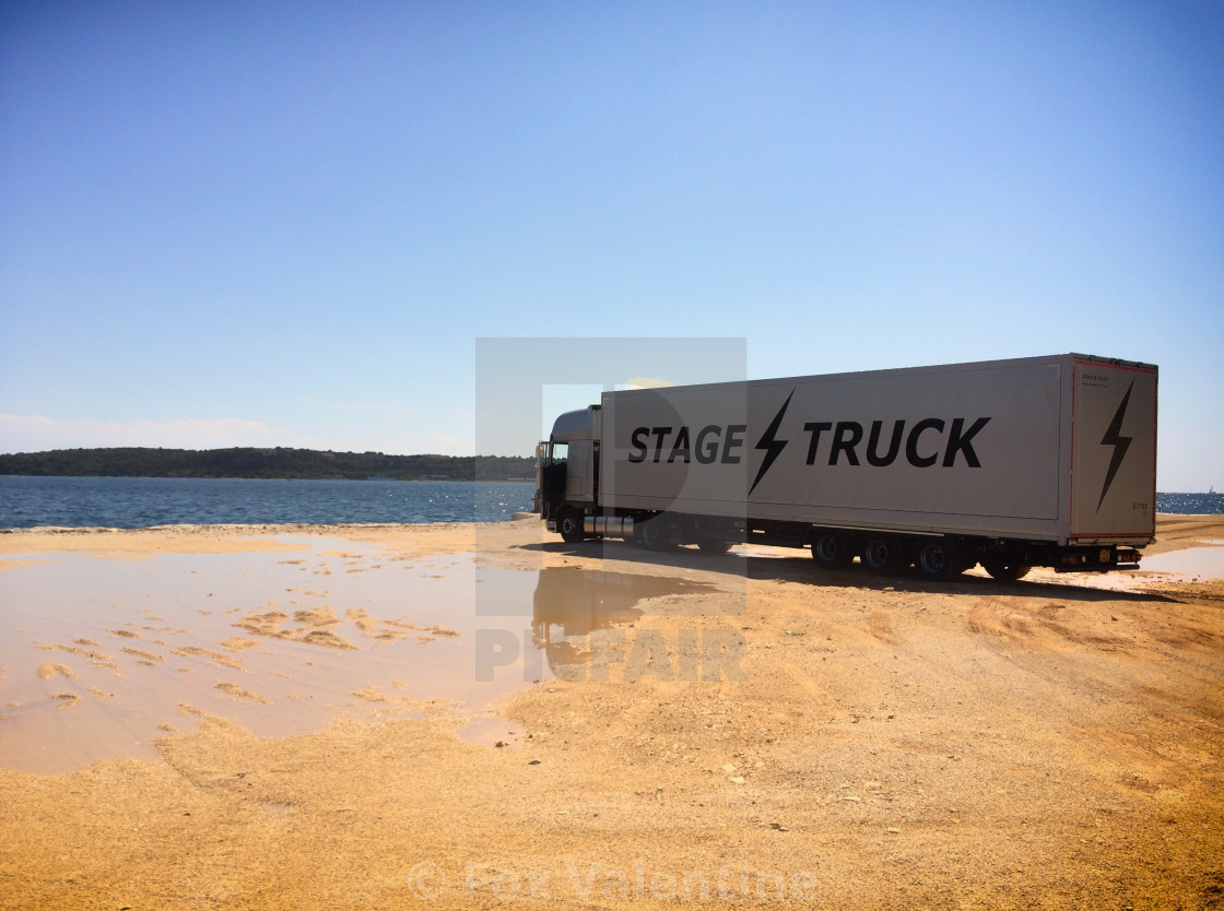 """Stage truck by the sea"" stock image"