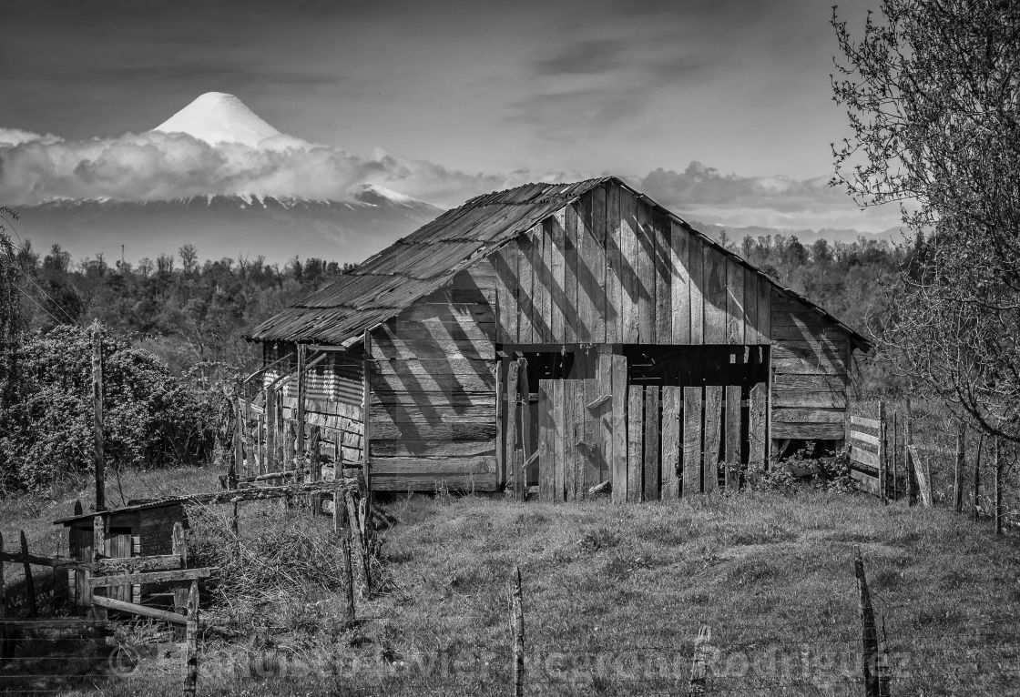 """Old house and the osorno volcano"" stock image"
