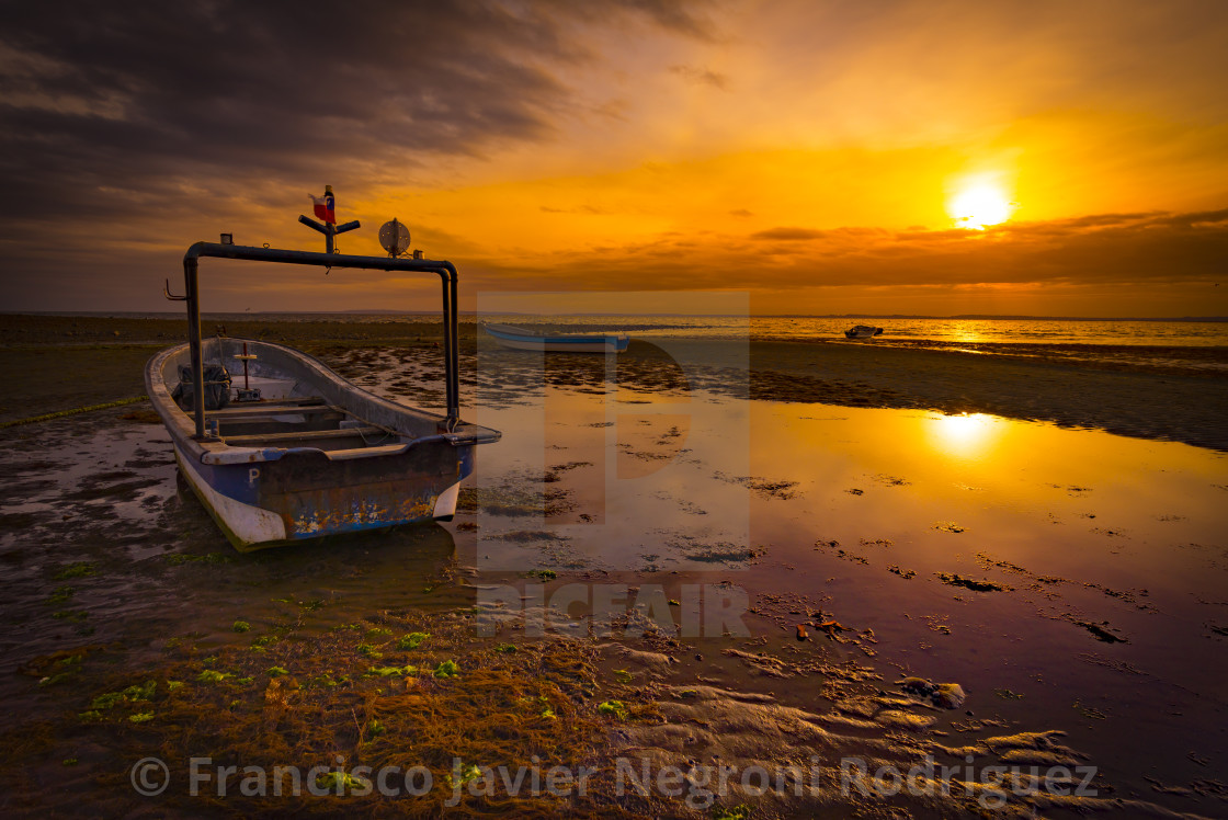 """Fishing boat at sunset"" stock image"