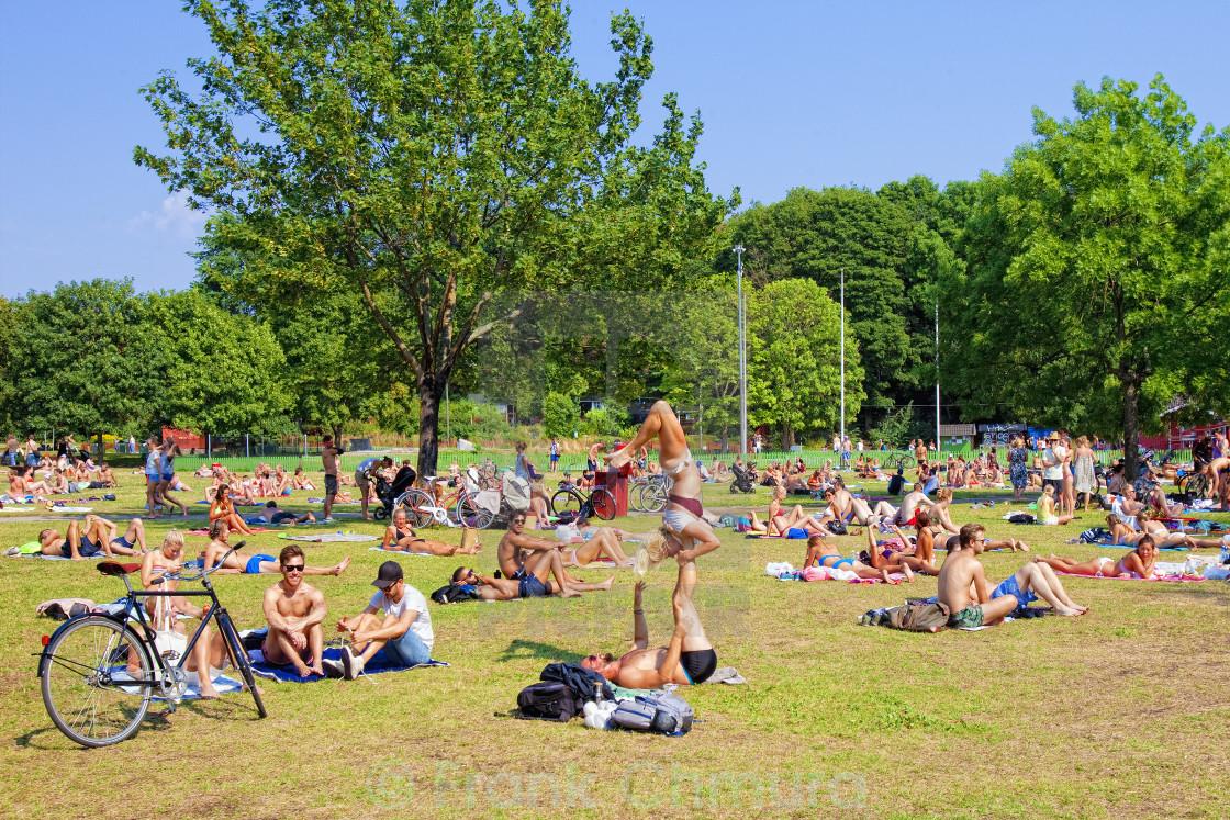 """Sweden, Stockholm - People Sunbathing at Hornstull in Summer"" stock image"