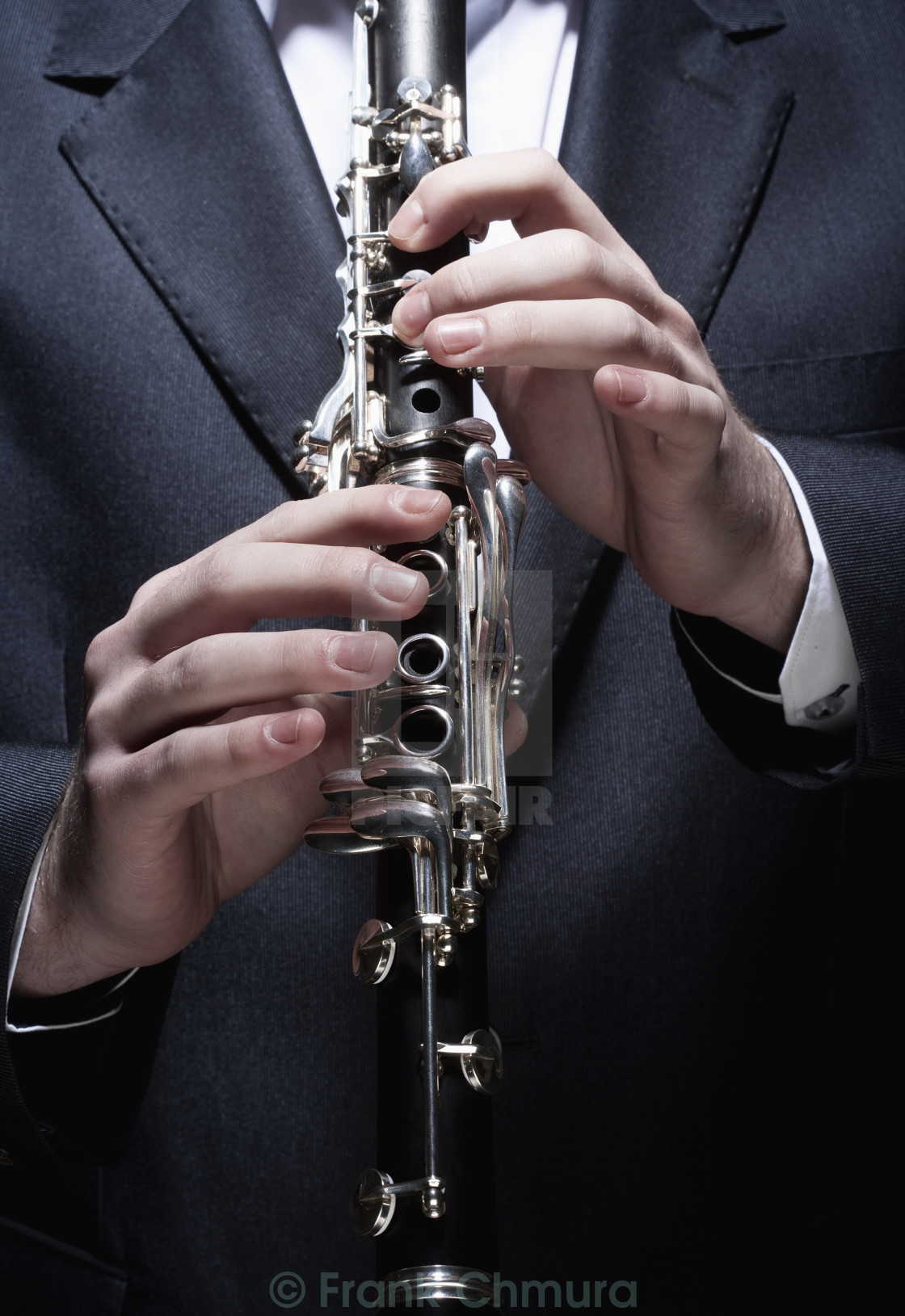"""Hands of Young Male Musician Playing Clarinet"" stock image"