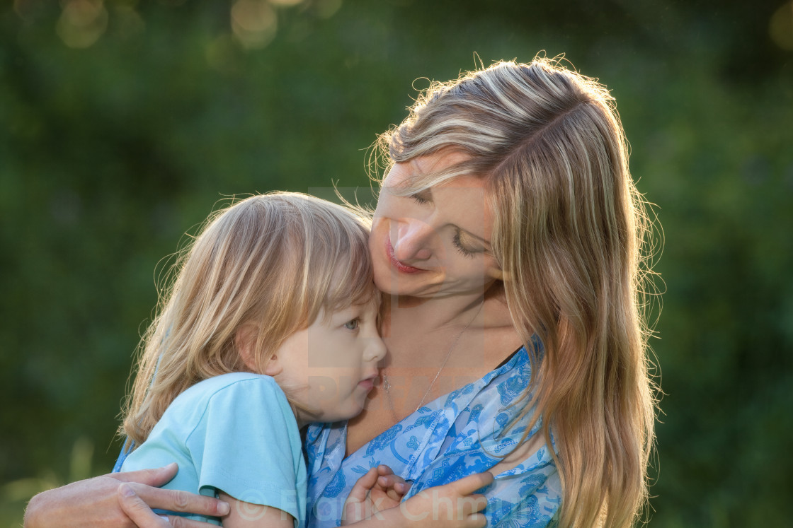 """""""portrait of mother and son sitting in the garden"""" stock image"""