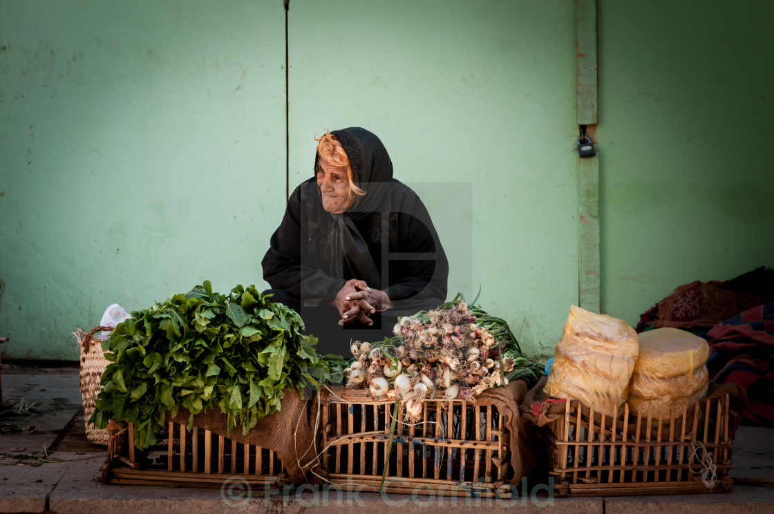 """Woman Selling vegetables, Aswan"" stock image"