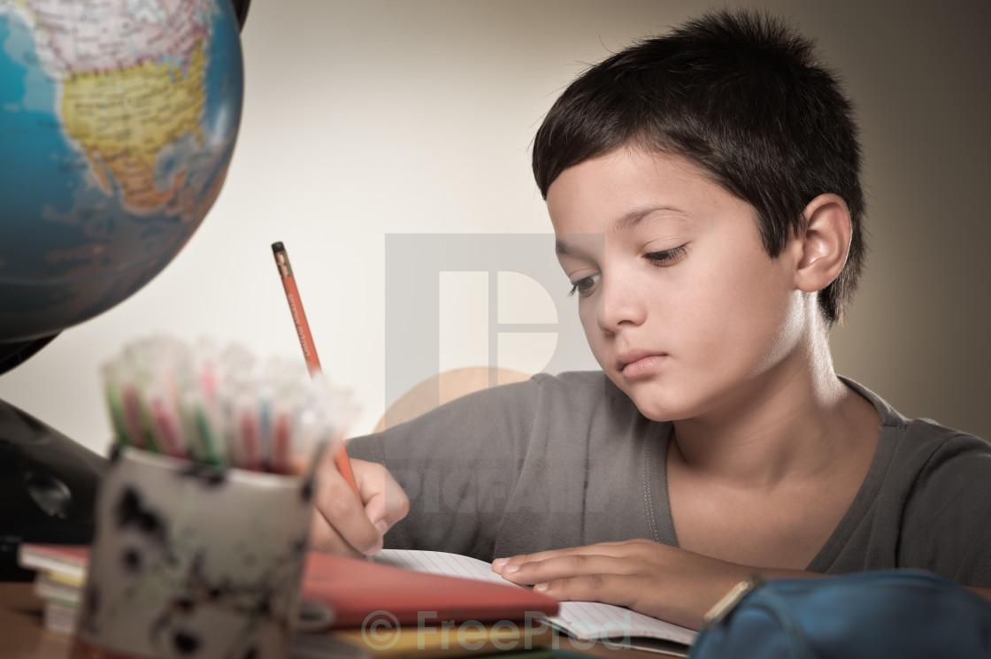 """Child writing at school"" stock image"