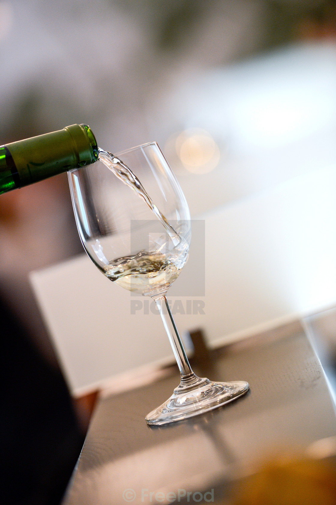 """Tasting-White wine pour in a glass"" stock image"