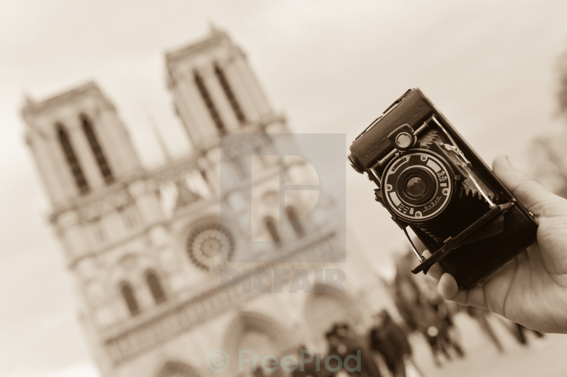 """France, Paris, young man taking photograph, Cathedral Notre-Dame"" stock image"