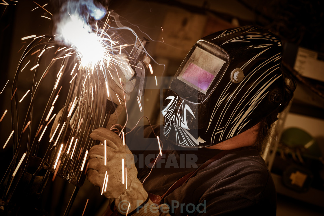 """Metal worker standing in workshop"" stock image"