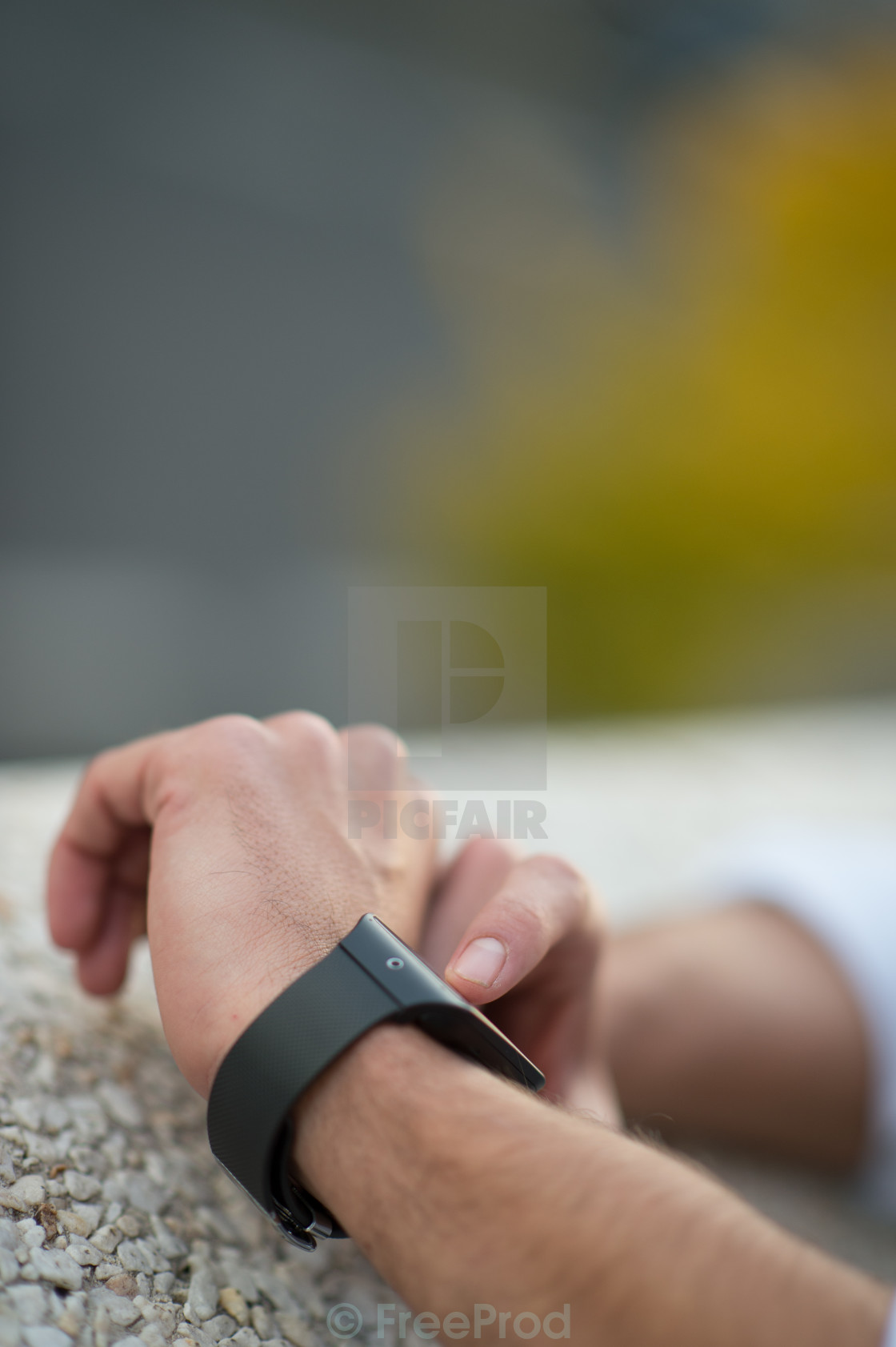 """Man with Mobile phone connected to a smart watch"" stock image"